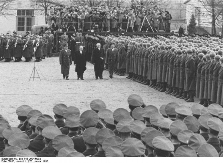 Andernach, Jan. 20.[19]56. On Jan 20.56. Chancellor Konrad Adenauer visited for the first time the newly established German Army at Andernach. The Chancellor reviewed Army, Navy and Airforce groups on the camp grounds and adressed the German Soldiers in a short speech after he was introduced by Defense Minister Theodor Blank. Chancellor Adenauer accompanied by Defense Minister Theodor Blank, and Camp Commander Col. Phiilip (far right) review troops. H-20041 H-20042